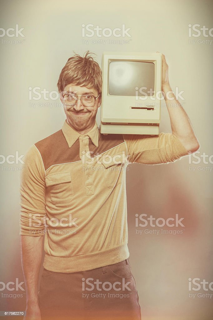 Funny Retro 1980s geek with computer on shoulder stock photo