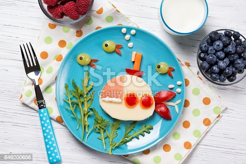 istock Funny sandwich with cheese in a shape of submarine and fishes, meal for kids idea 646200656