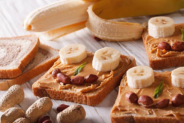 funny sandwiches with peanut butter and banana horizontal - peanutbutter bildbanksfoton och bilder