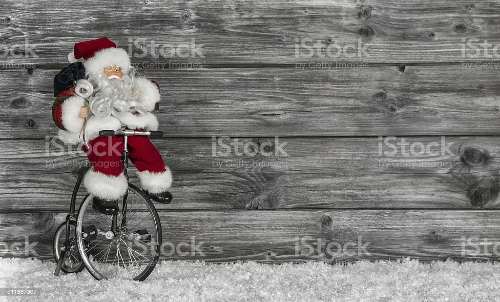 Funny Santa buying christmas presents decorated on wooden background. stock photo