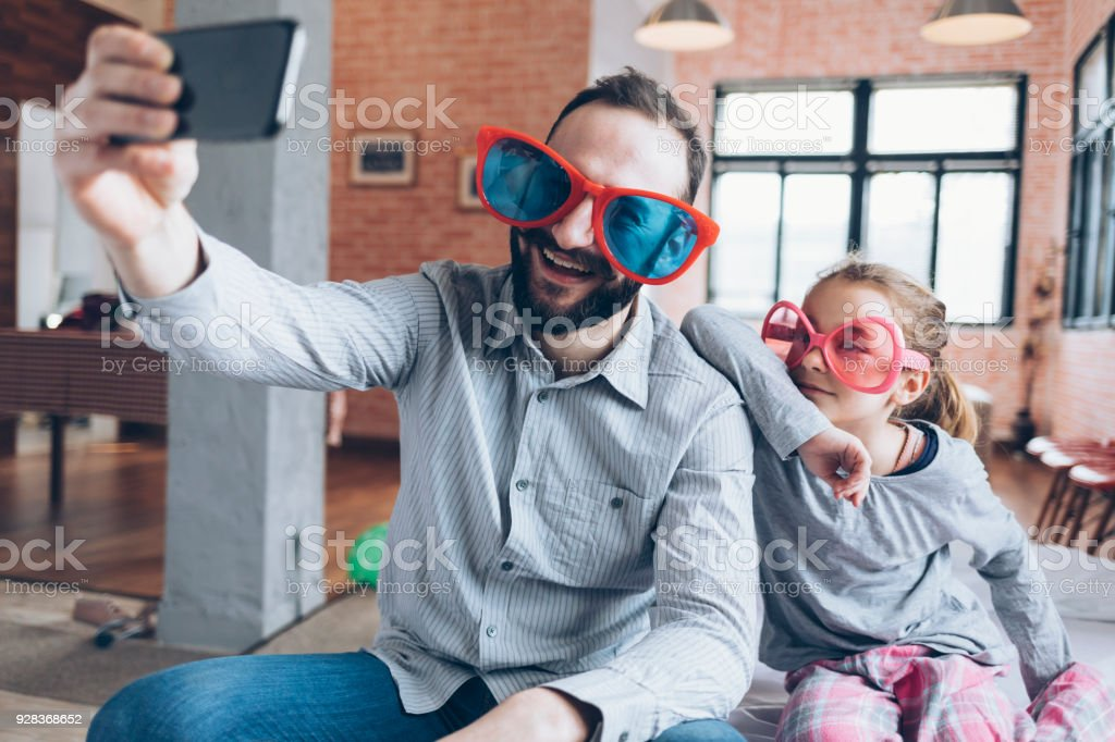 Funny selfie father and daughter stock photo