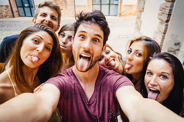 funny selfie in the city - mensentong stockfoto's en -beelden