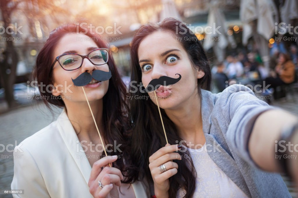 Funny selfie with mustaches royalty-free stock photo