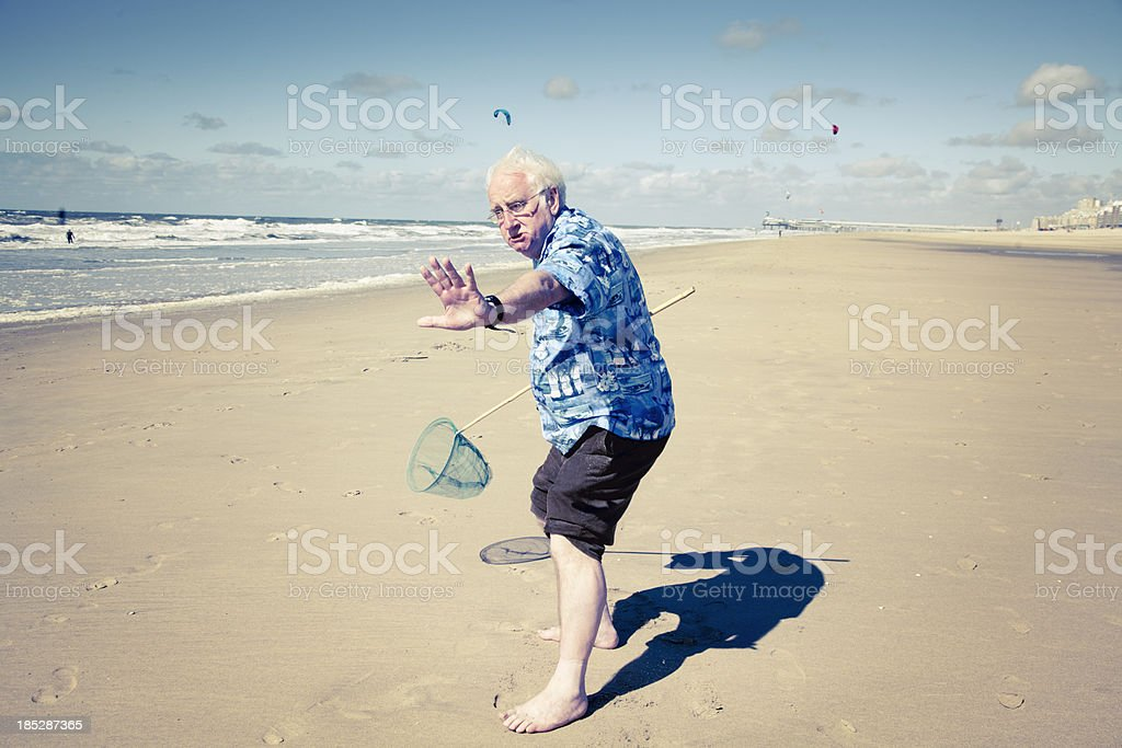 funny senior tourist at beach stock photo