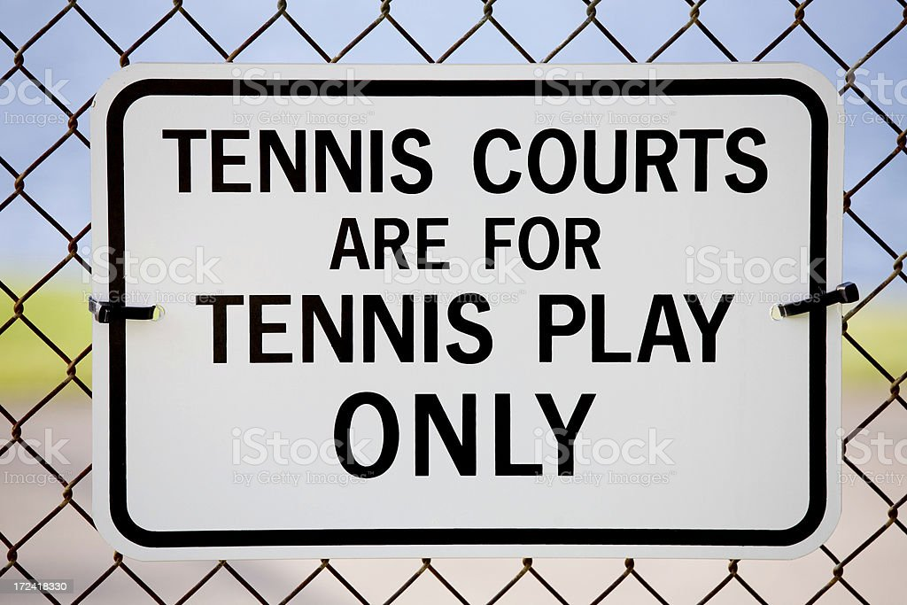 funny sign staring that only tennis activities are allowed royalty-free stock photo