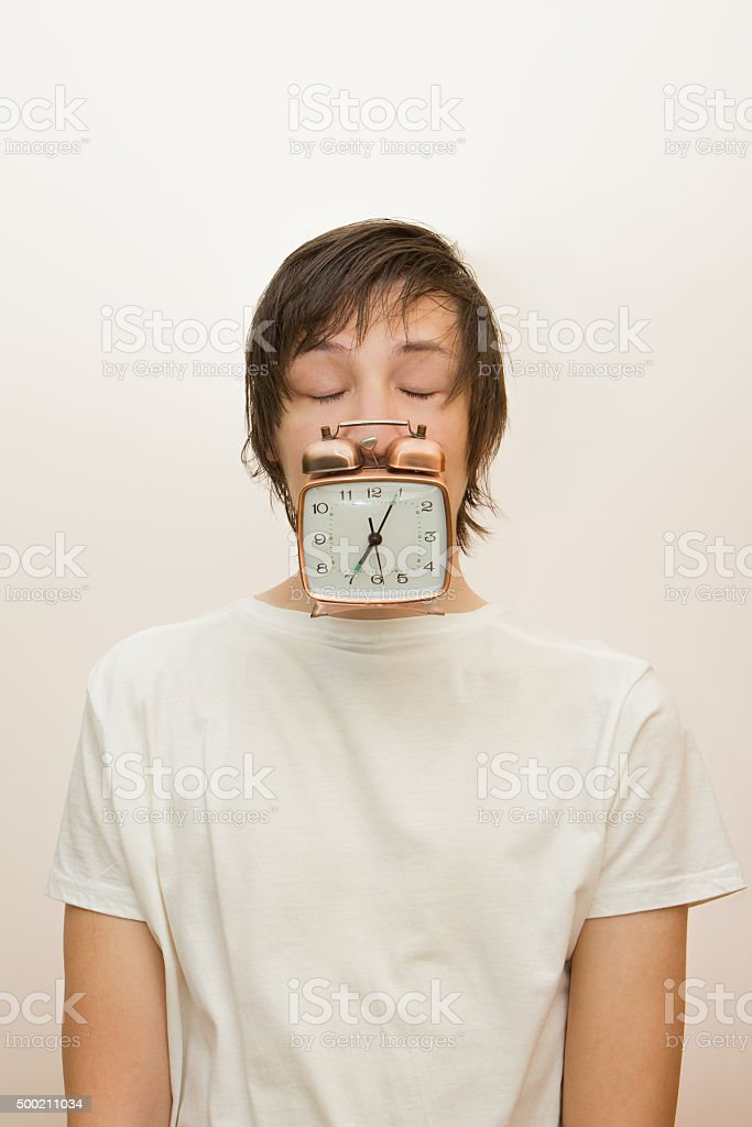 Funny Sleeping White Man Hold In Mouth Alarm Clock Stock