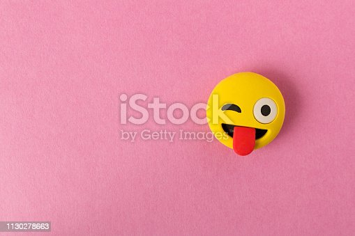 istock Funny smiley face on pink background. Positive mood. Empty text space. 1130278663