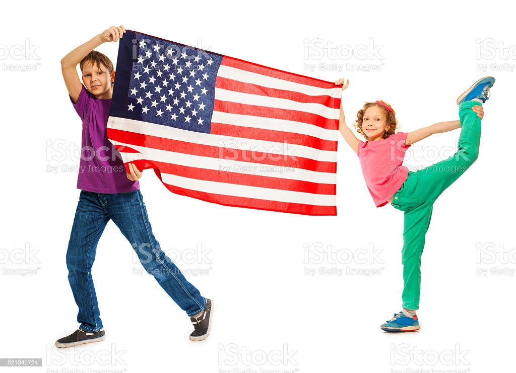 Funny smiling kids waving American flag stock photo