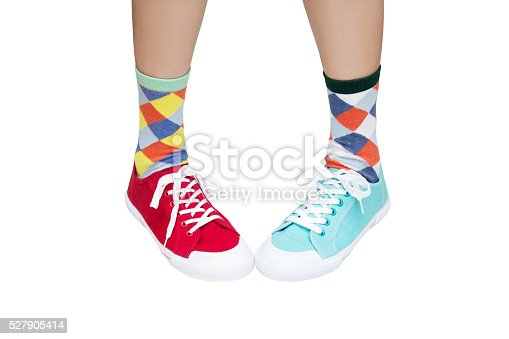 wearing funny socks and different sneakers on legs
