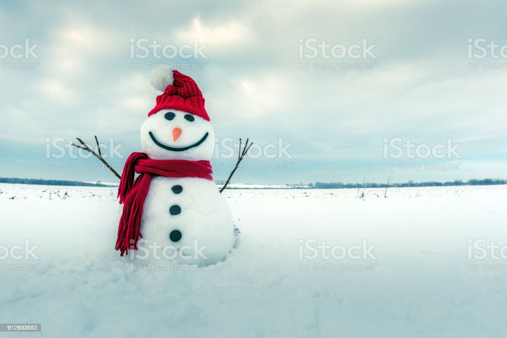 Funny snowman in red hat stock photo