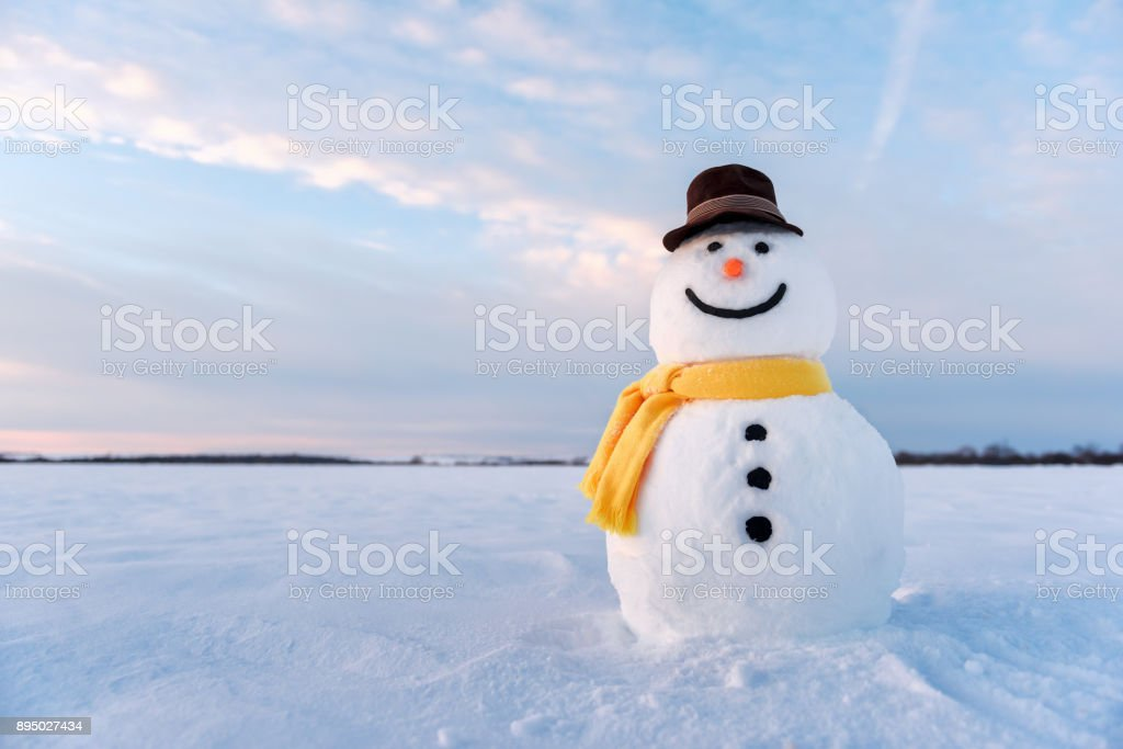 Funny snowman in yellow hat stock photo