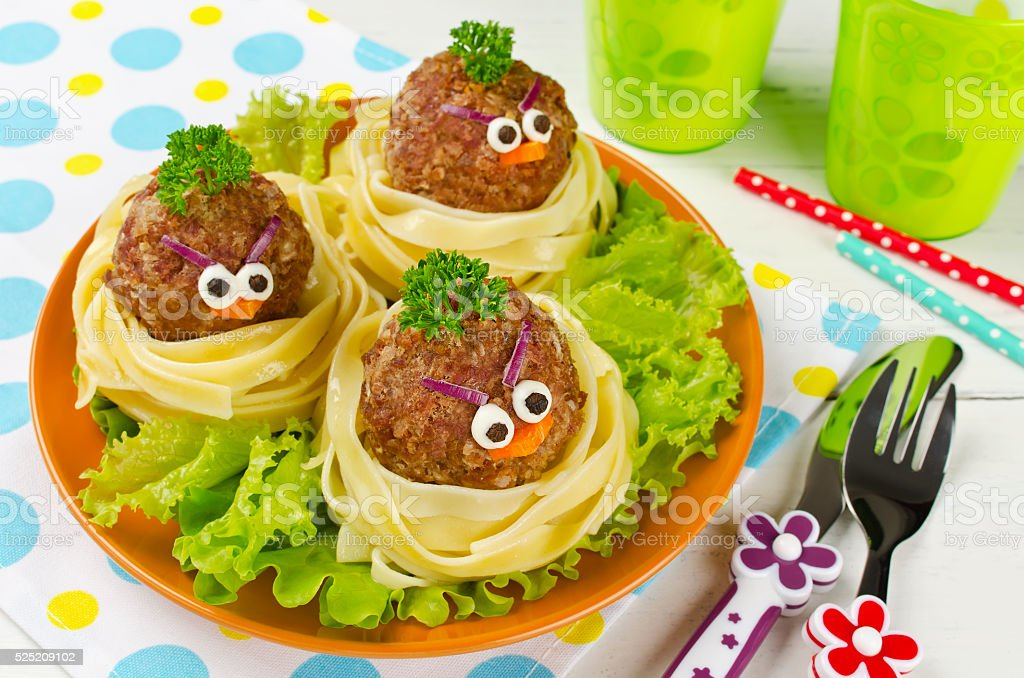 Funny spaghetti with meatballs for kids stock photo
