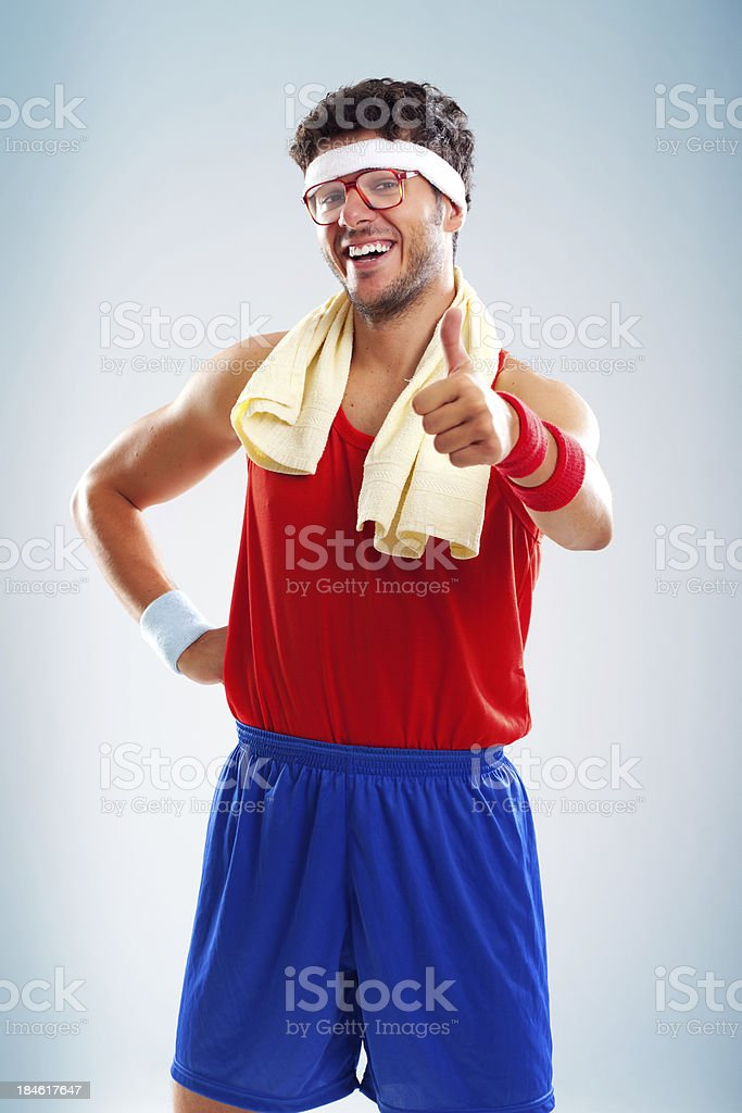 Funny sportsman with glasses holding thumb up royalty-free stock photo