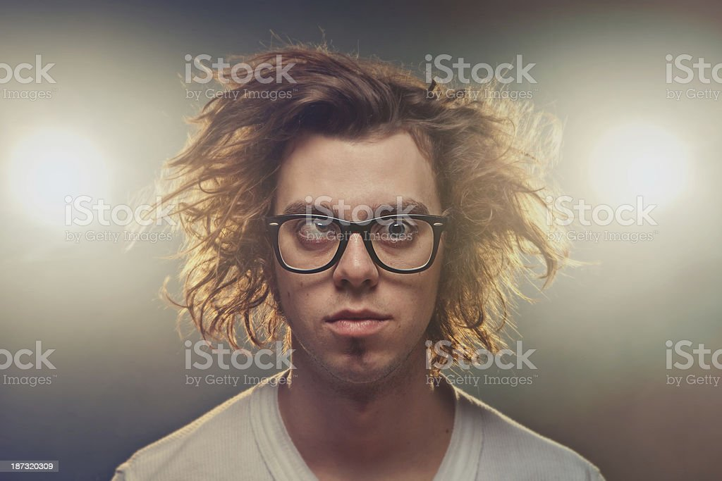 Funny Squinting man with Tousled brown hair in studio stock photo