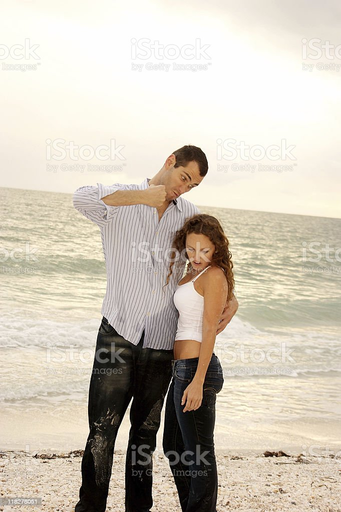 funny tall man pretending to punch short woman stock photo