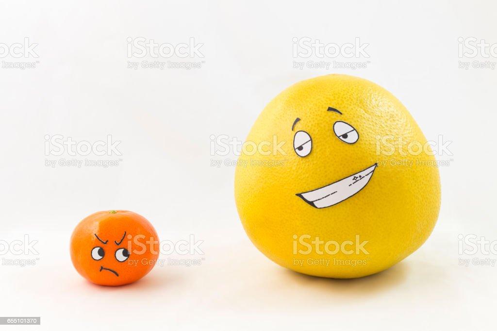Funny tangerine and pomelo stock photo
