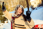 funny teenager girl portrait with the snow on the hair. Winter, outdoor, daylight.
