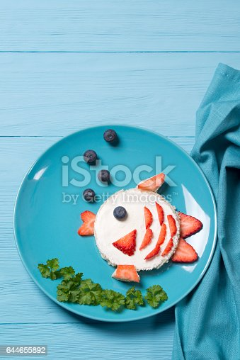 istock Funny toast in a shape of fish, sandwich with cream cheese and berries, food for kids idea, top view 644655892