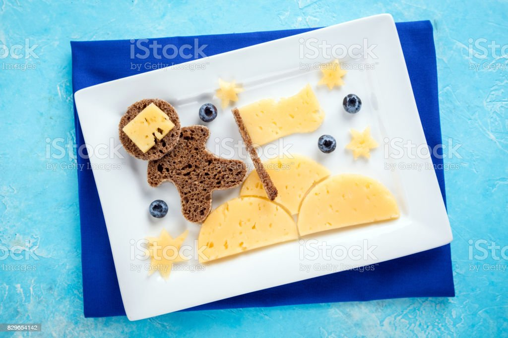 Funny toast with cheese and berries for kids breakfast or lunch stock photo