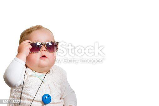 Funny photo of a little girl wearing sunglasses