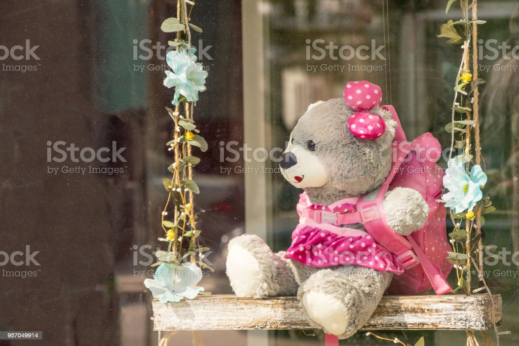Funny toy bear on beautiful wooden teeter-totter stock photo