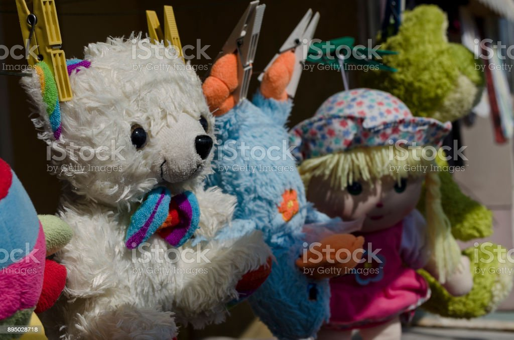 Funny toys hanging on the line stock photo