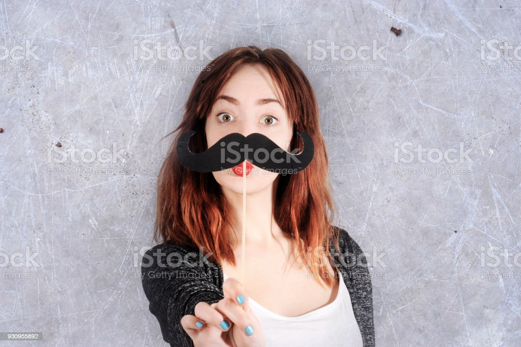 funny trendy fashion girl with paper mustache playing with emotion royalty-free stock photo