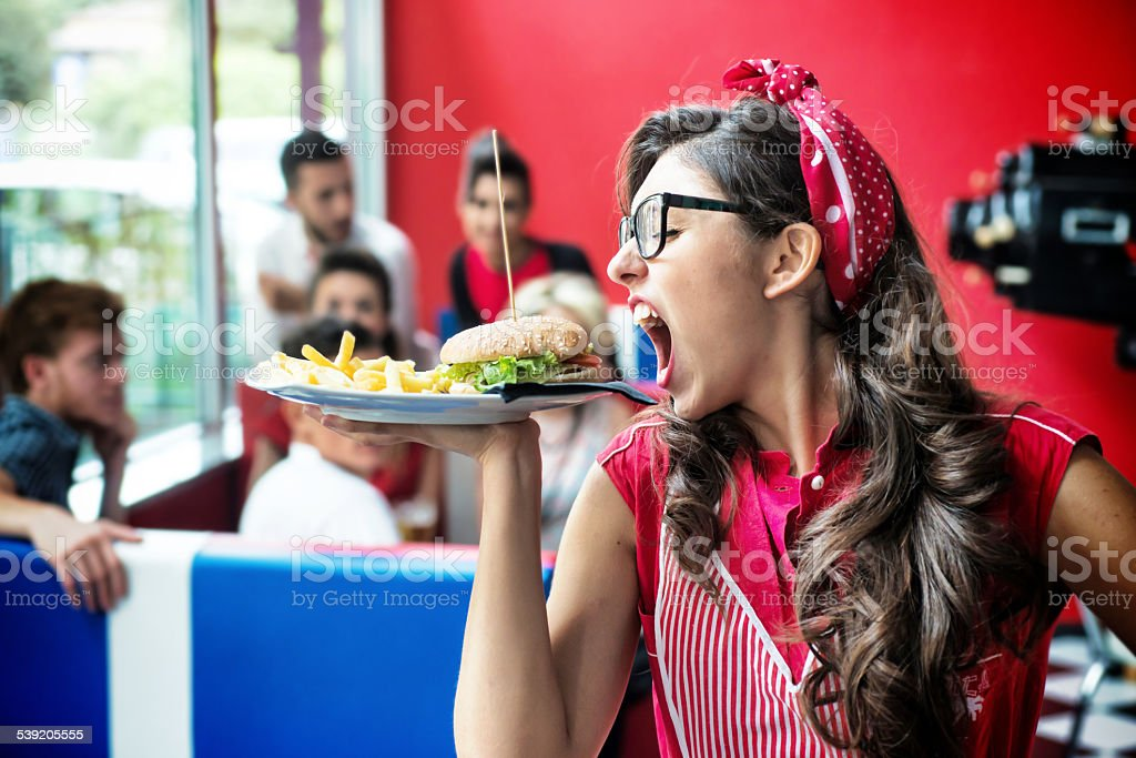 Funny Waitress and Hamburger with French Fries stock photo