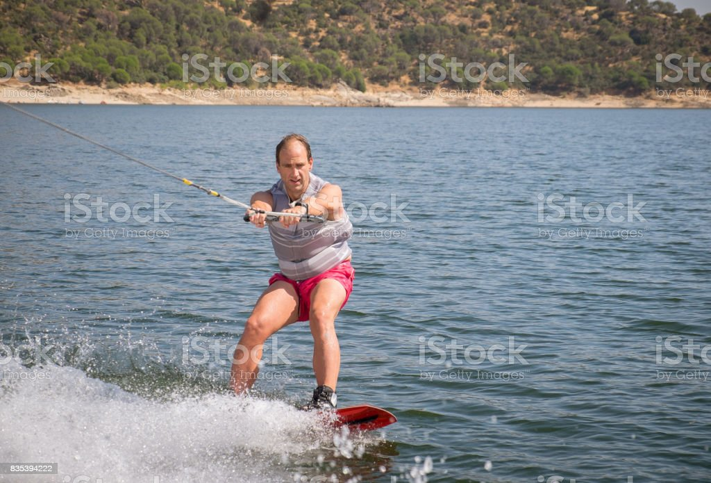 Funny wake-boarding sport on the lake