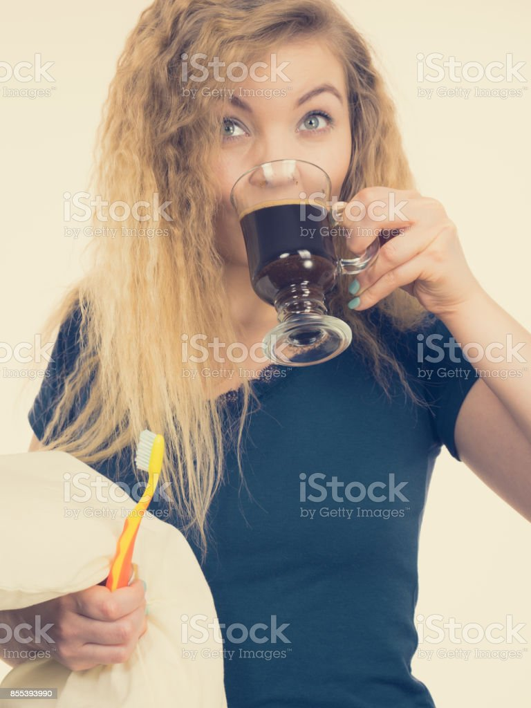Funny woman being late drinking coffee stock photo