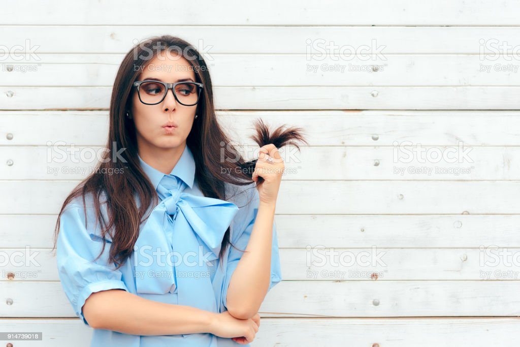 Funny Woman Checking Her Hair for Split Ends stock photo