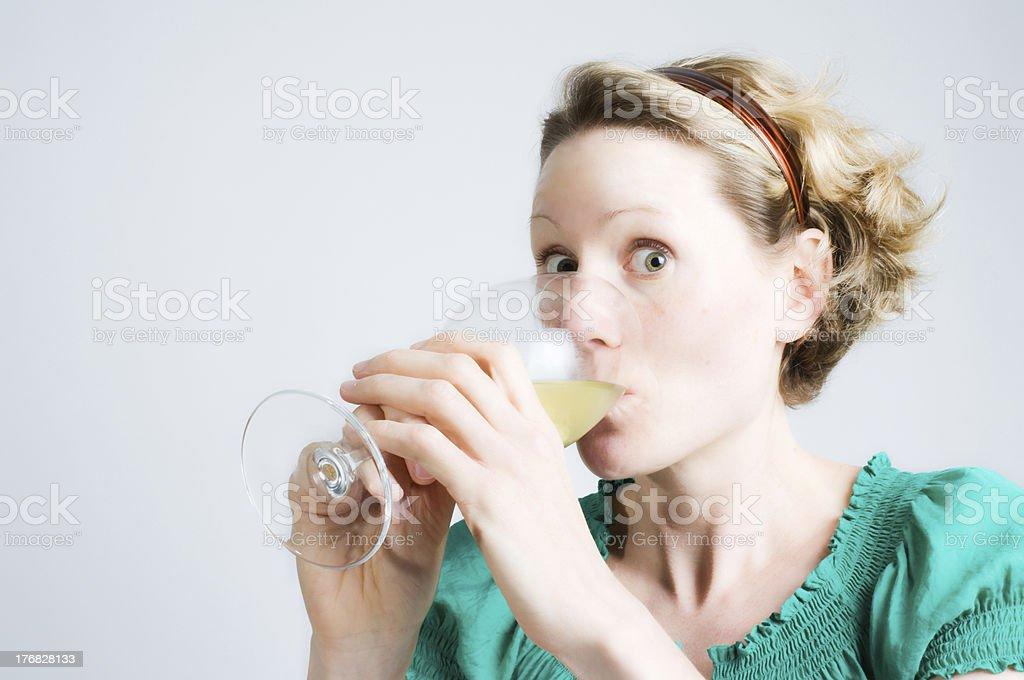 Funny Woman Guzzling White Wine royalty-free stock photo