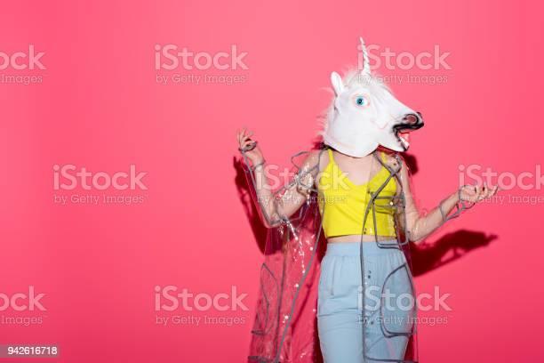 Funny woman in fashionable transparent raincoat and unicorn mask on picture id942616718?b=1&k=6&m=942616718&s=612x612&h=icd1msumk rvmwbo97wacygw npi8kt1gnj jobbhxo=