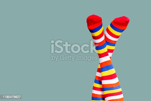 Funny woman legs isolated over green
