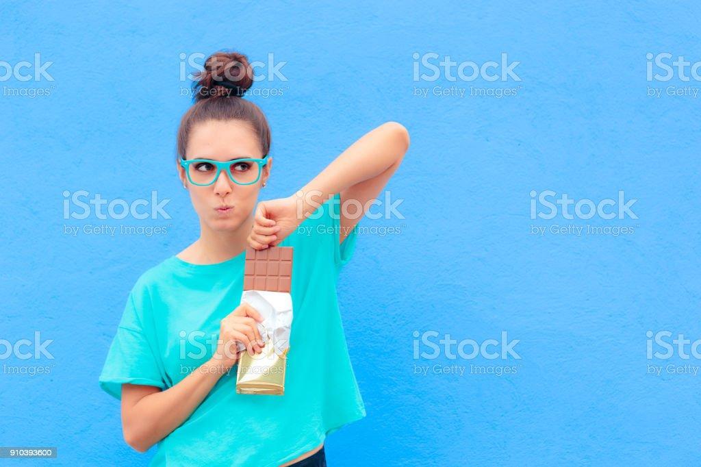 Funny Woman on Diet Craving Big Dessert Chocolate Bar stock photo