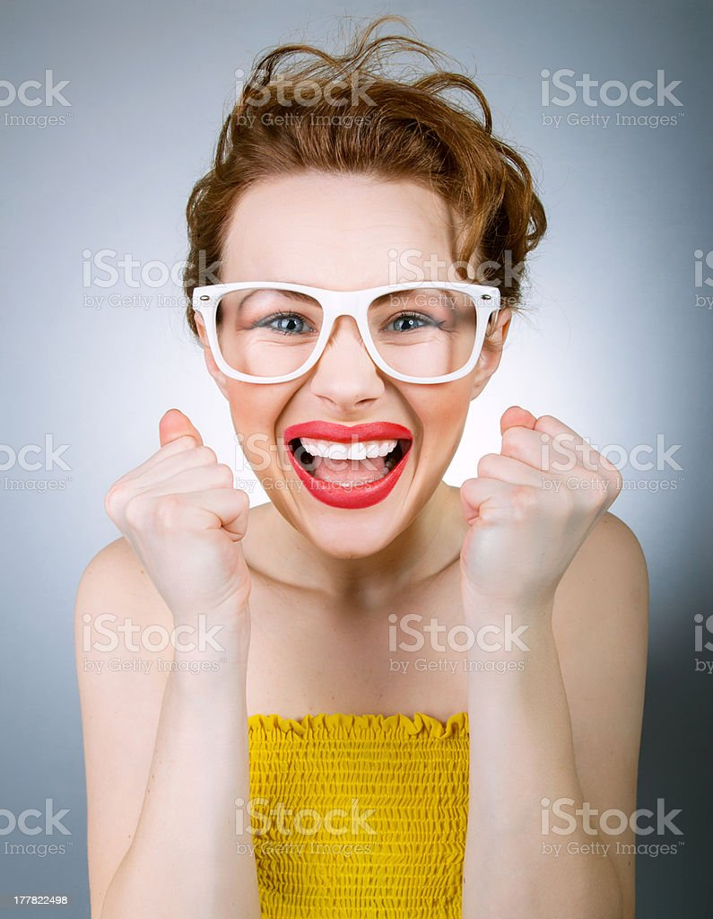 Funny woman with clenched fist royalty-free stock photo