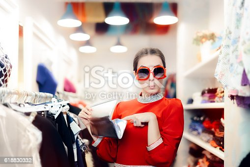 istock Funny Woman with Oversized Sunglasses and Silver Clutch Bag 618830332