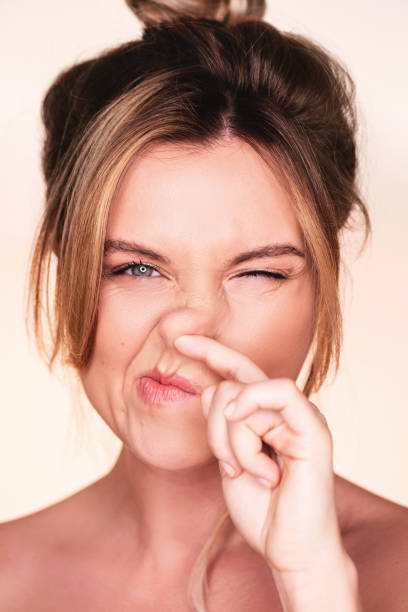 Funny woman with picking finger in her nose stock photo