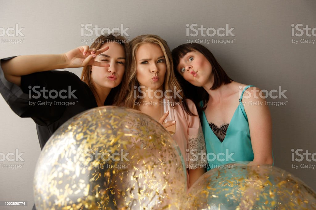 Funny women celebrating the bridal party, at home. stock photo