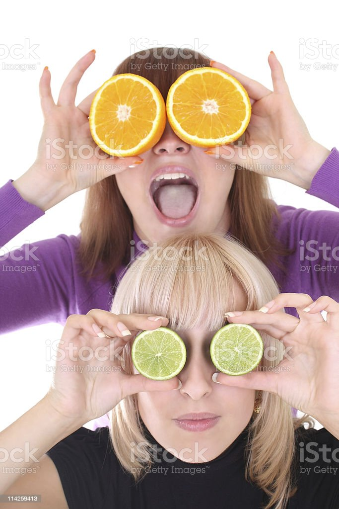 funny women with orange and lime slices instead of eyes royalty-free stock photo