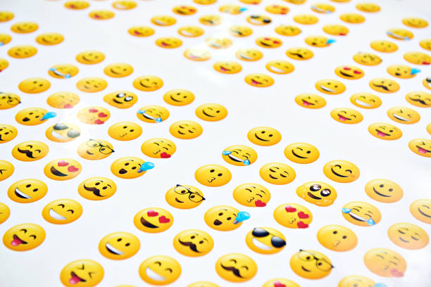 funny yellow smileys on a white - emoji foto e immagini stock