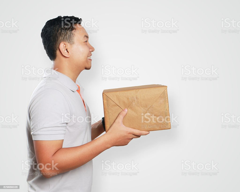 Funny Young Asian Courier Guy Giving Package Box ストックフォト