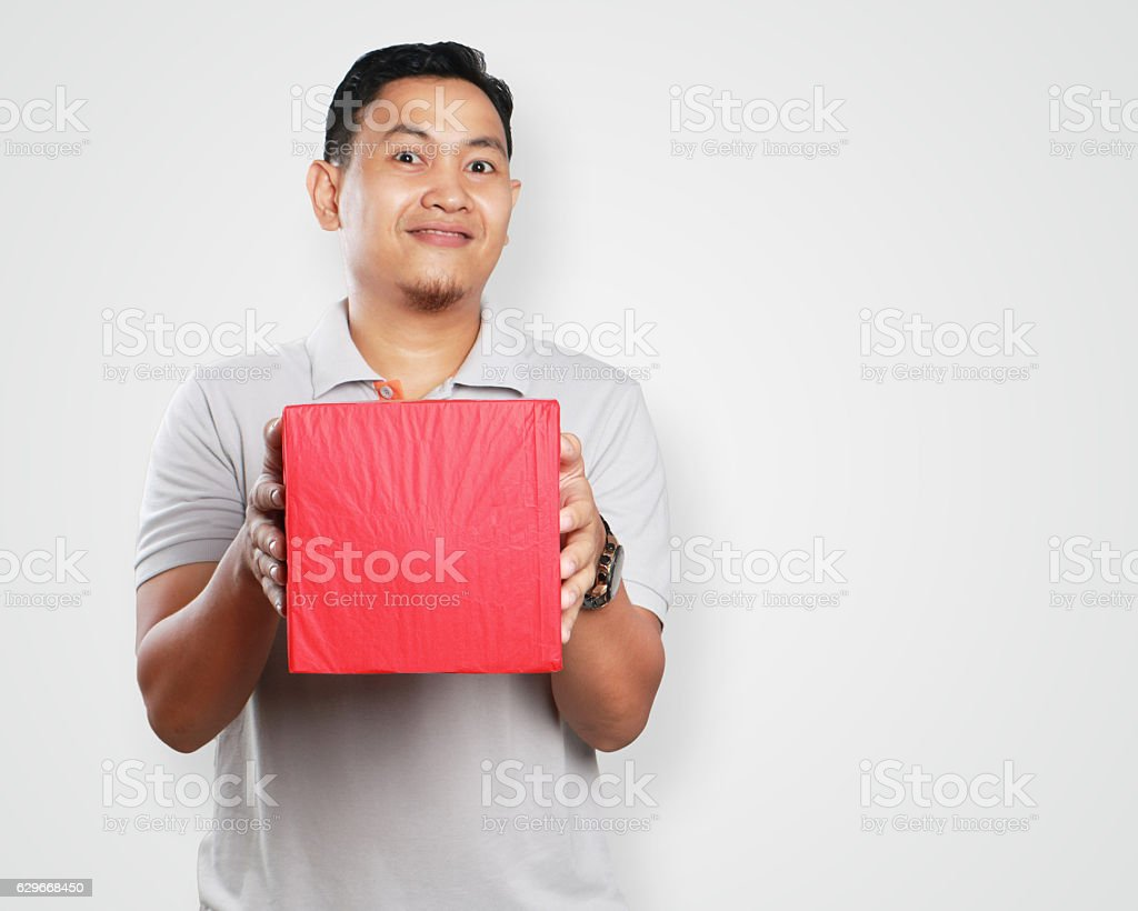 Funny Young Asian Guy Giving Gift Box ストックフォト