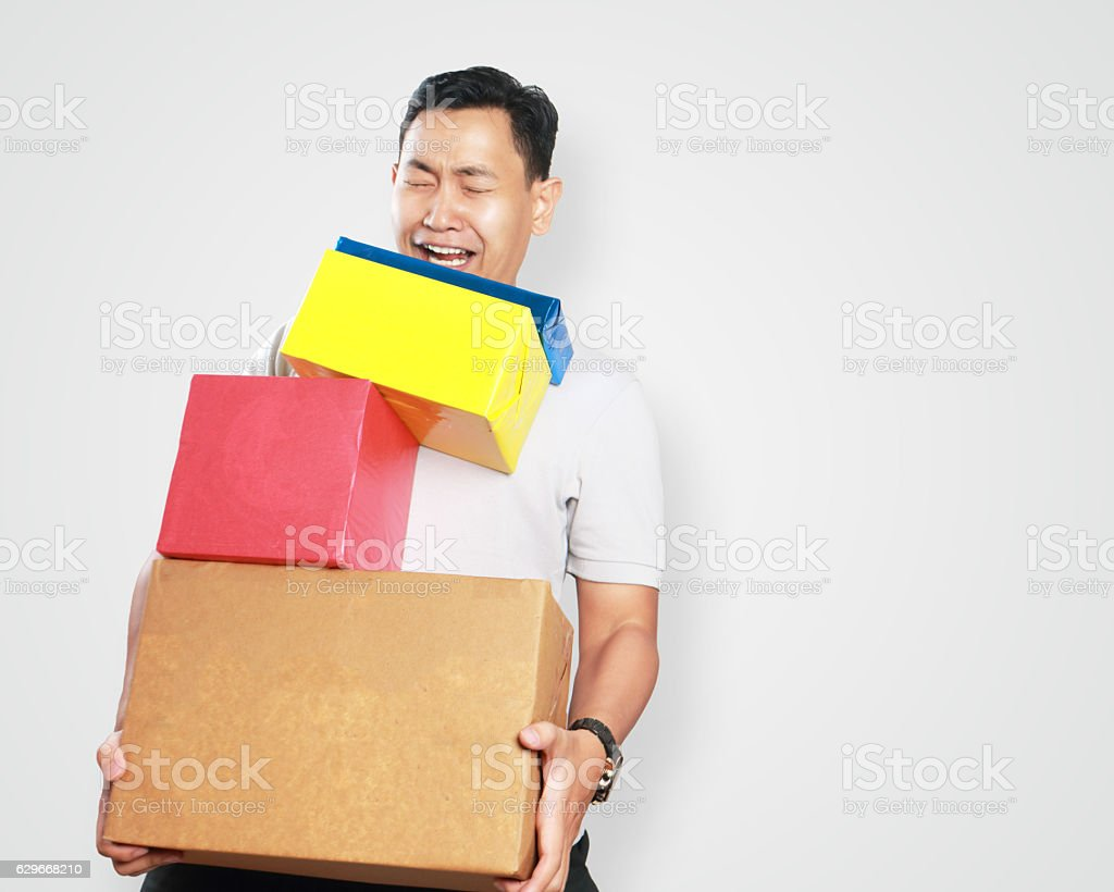 Funny Young Asian Guy Holding Lots of Gift Box ストックフォト