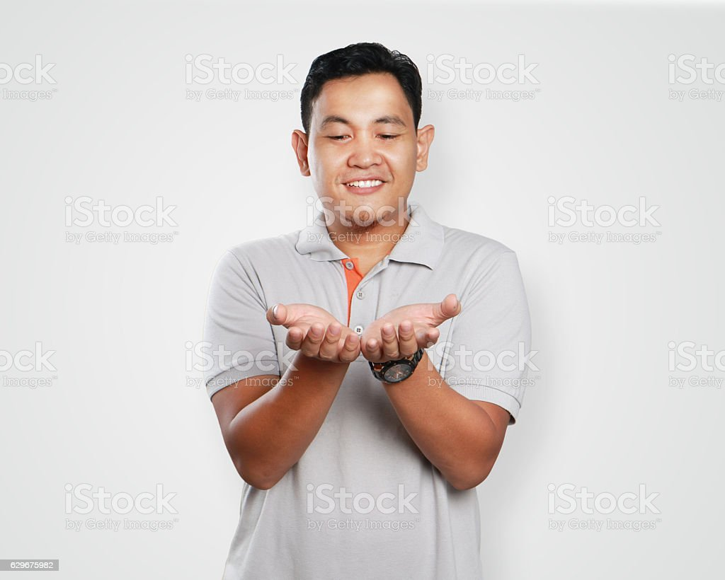 Funny Young Asian Guy Showing His Open Palm stock photo