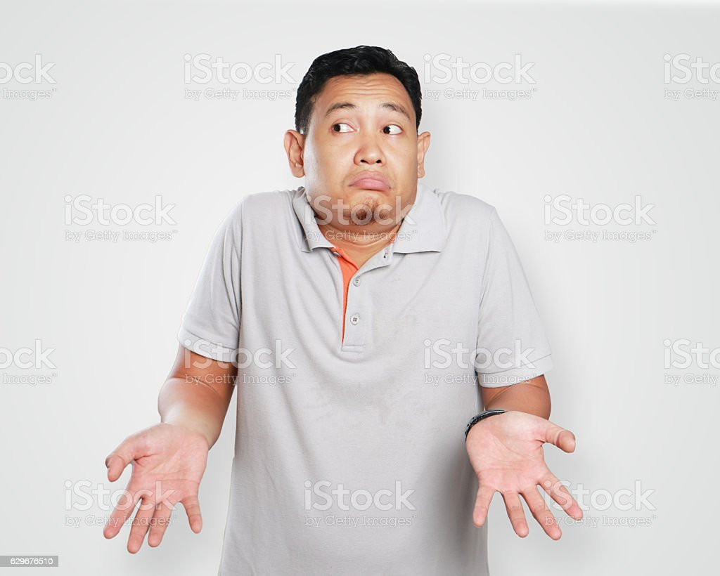 Funny Young Asian Guy Shrug Gesture stock photo