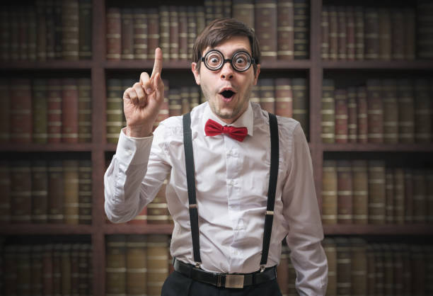 funny young man (nerd) with finger up has an idea. - genius stock photos and pictures