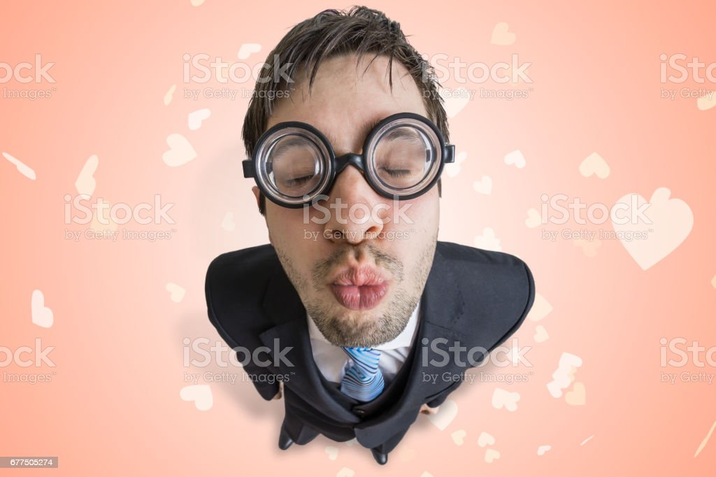 Funny young nerd or geek is giving a kiss. stock photo
