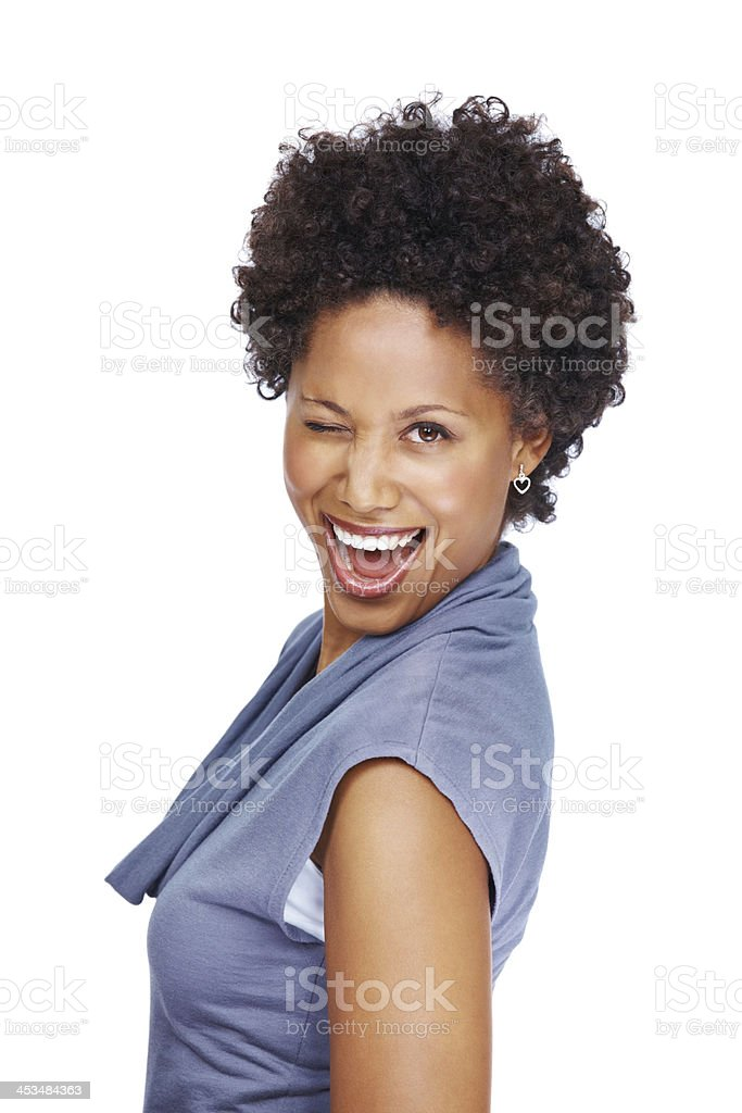 Funny young woman blinking eye at you against white stock photo