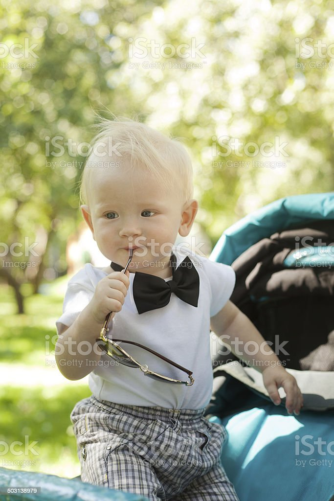 funny-year-old kid in a bow tie with sunglasses stock photo